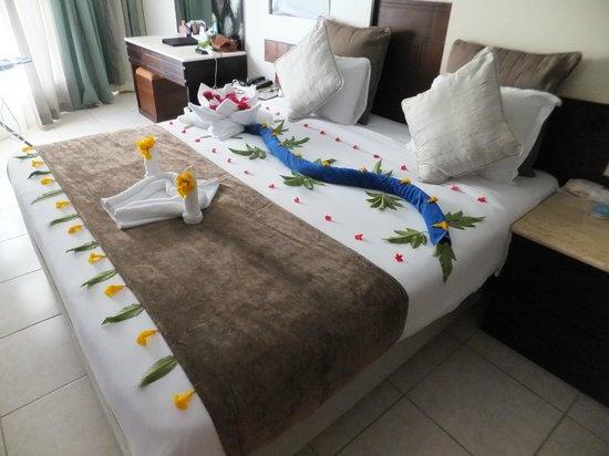 Sharming Inn Hotel: Towel art - fresh flowers