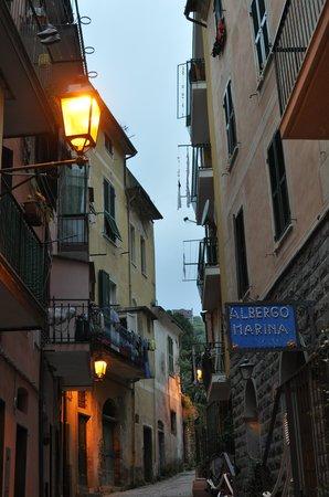 Albergo Marina: Hotel sign and road