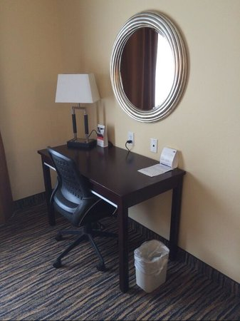 Holiday Inn Express & Suites Denver North: Desk and chair. A USB plug to recharge my phone would have been appreciated.