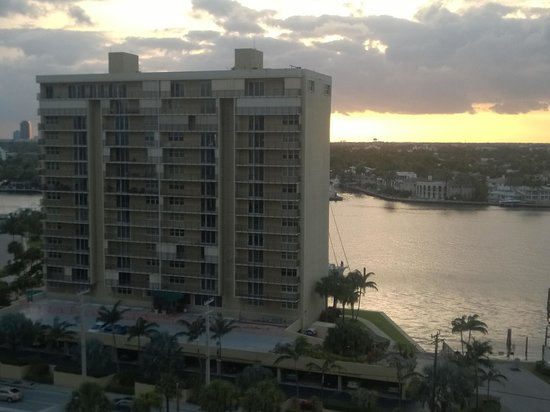 Marriott's BeachPlace Towers: View from our balcony as the sun set behind the fairly run-down condo on the Intercoastal side f