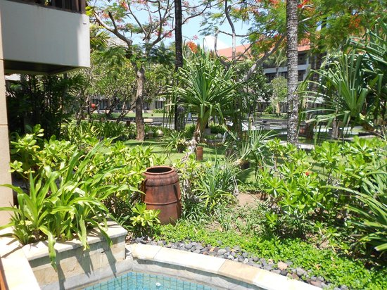 Conrad Bali: view of hotel garden between buidling 2 and 3