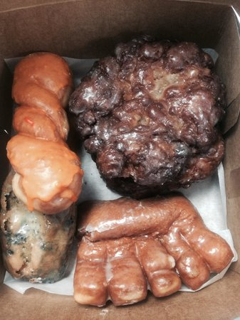 Sunny's Donuts : The Bear Claw is shaped like a hand! Blueberry buttermilk bar, orange twist and fritter!Yum! Don