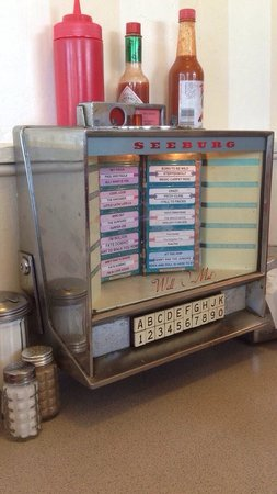 Jukebox player at each table - Picture of Clayton's Coffee Shop