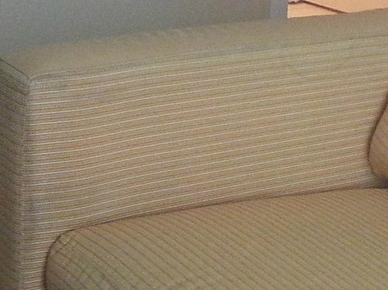 TownePlace Suites Erie : stained and worn loveseat
