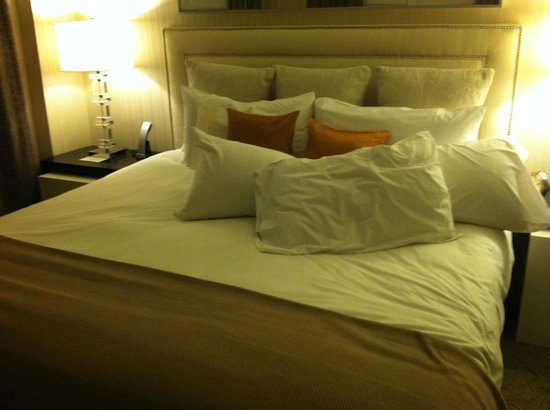 "The Benjamin: One-bedroom suite king-sized bed with ""pillow menu"" pillows"