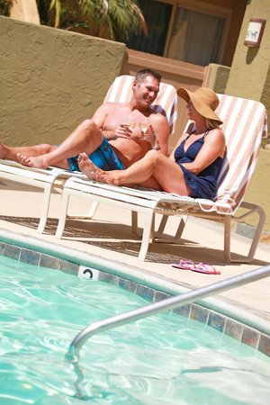 Winners Circle Resort: Couple Lounging by WCR Pool
