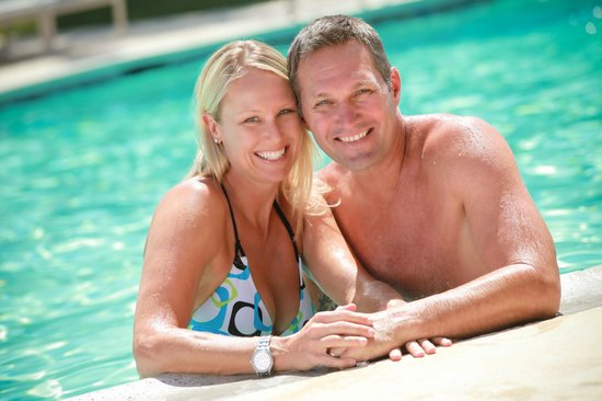 Winners Circle Resort: Couple Enjoying WCR Pool