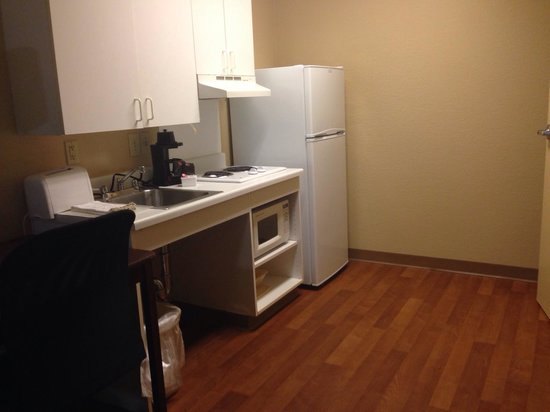Extended Stay America - Jackson - North : kitchenette with wood floors and small table for office work or dining