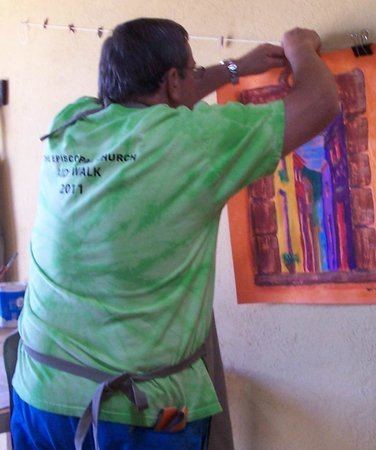 Cristi Fer Art Gallery and Workshops : Participant taking a step back to appreciate the work