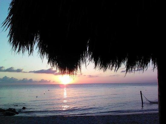 Secrets Aura Cozumel: Sunset from our beach lounger (margarita in hand)