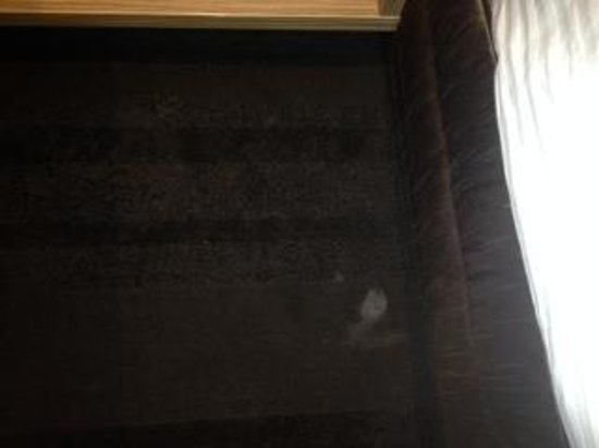 Crowne Plaza Hotel Canberra: white stain by floor of bed - lovely
