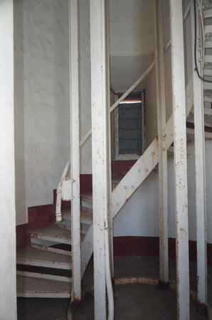 Cape Bolinao Lighthouse: A view through the barred grille, showing the spiral staircase.