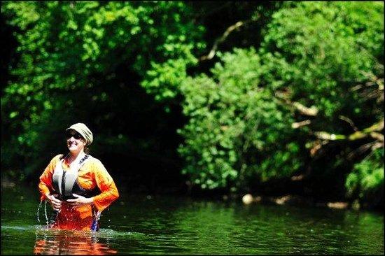 Wye Canoes Ltd: A Canoeist taking a dip in the Wye