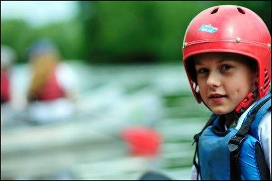 Wye Canoes Ltd: A child enjoying a canoe trip on the River Wye.