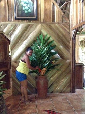 Hotel La Costa de Papito : Katia cuts fresh flowers from property & decorates!