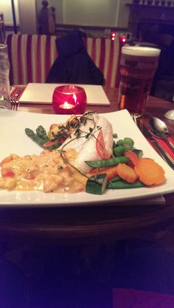 Millers Restaurant: Baked cod with crab lasagna and pink prawn suace.