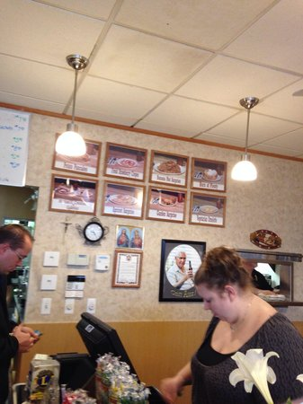 The Pantry: Note family photos on the wall with specialty dishes and Catholic religious artifacts for distri