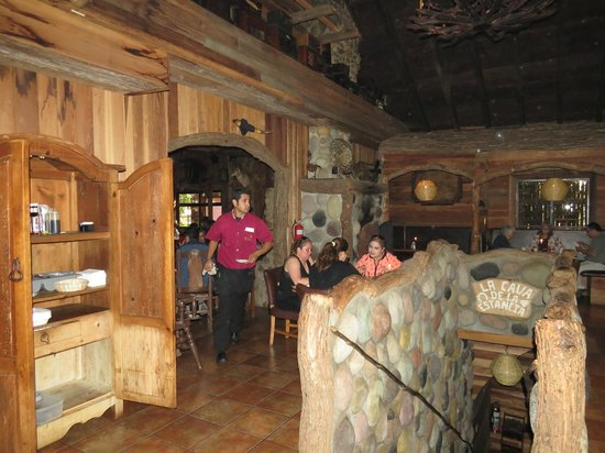 La Estancia Steak House: Inside dining room and stairway to downstairs wine cellar.