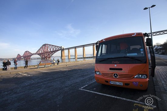 The Hairy Coo - Free Scottish Highlands Tour : Dolly, the Hairy Coo Bus, parked at the Forth Bridge.