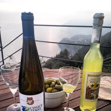 Wine, limoncello, and a view from the patio of Luna di Marzo