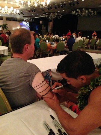 """Te Moana Nui, Tales of the Pacific: Getting a """"tattoo"""" at one of the activity tables"""