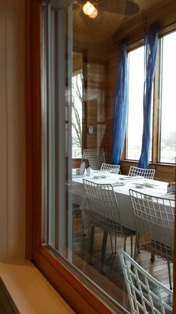 Cerulean: Dining room overlooking water.