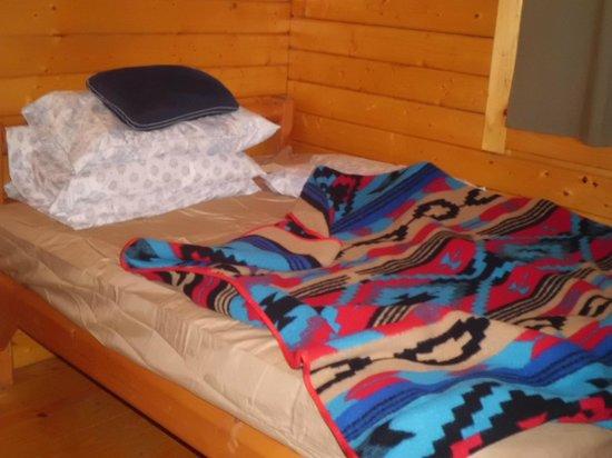 Frontier Town: One of two bedrooms in deluxe cabin