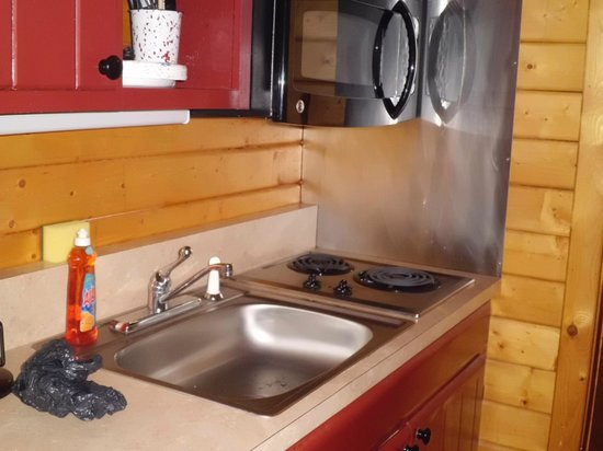 Frontier Town: Kitchen area of deluxe cabin