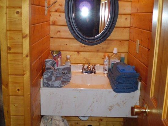 Frontier Town: Bathroom vanity area in deluxe cabin