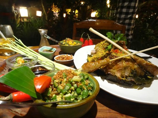 Bumbu Bali: 1/2 Roast duck in banana leaf with some of the many trimmings