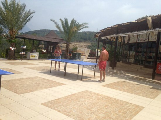 Utopia World Hotel: ping pong tables in the main pool area