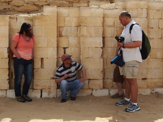 Egypt Tours by Abdo El-Lahamy Private Tour Guide: Zoser's Pyramid in Saqqara.  Abdo explaining the evolution of the pyramid