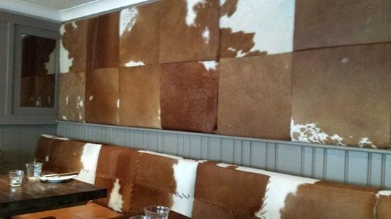The Lazy Cow Restaurant: cow hide wall and furnishings