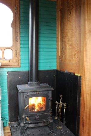 Roulotte Retreat: Log burner in sitting/kitchen area