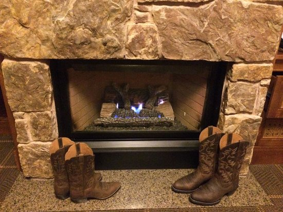 Four Seasons Resort and Residences Jackson Hole: Boots in front of fireplace