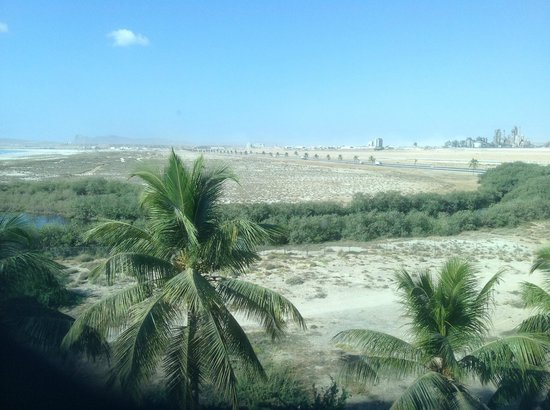 """Hilton Salalah: View of cement works from """"sea view"""" room"""