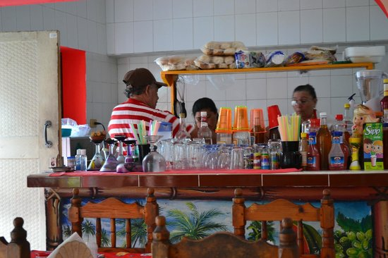 "Rene & Renee : ""Grandpa"" Rene behind the bar making drinks"