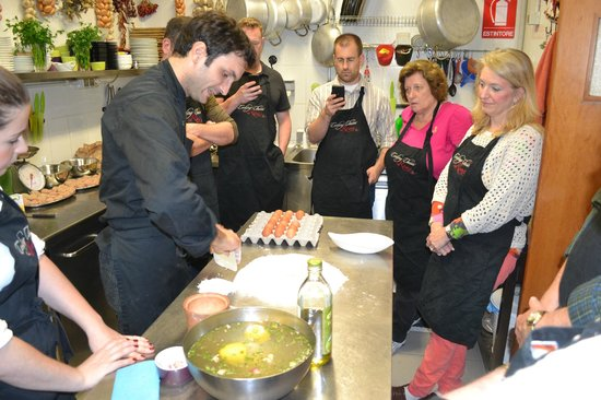 Cooking Classes in Rome : Making the well for the pasta dough