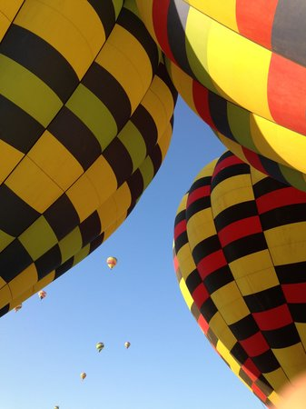 Balloons Above the Valley: Balloons filling up