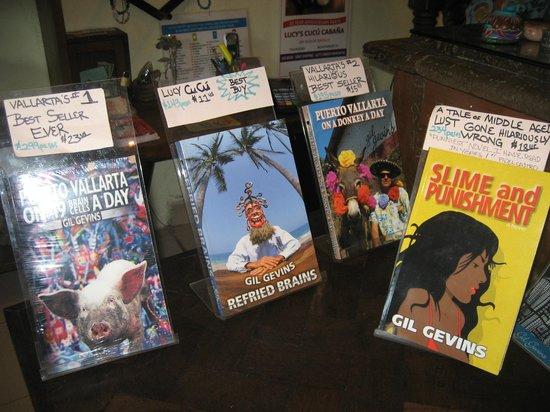 Lucy's CuCu Cabaña: Gil's books he has written.