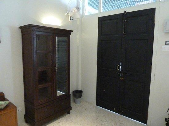 Noordin Mews: Antique cabinet in room