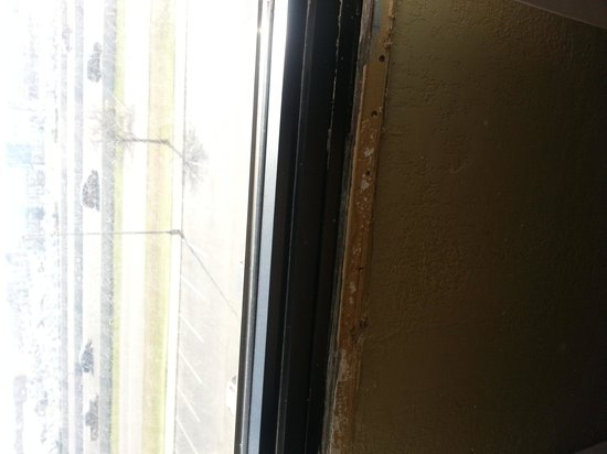 The Norman Hotel: Dirty Window and sill