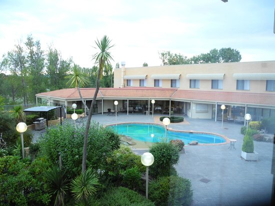 Best Western Plus Garden City Hotel: view to pool area