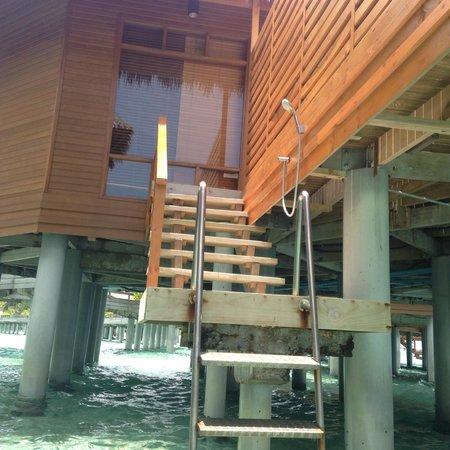 Baros Maldives : the decking leading into the ocean from villa, nice to have water to shower off