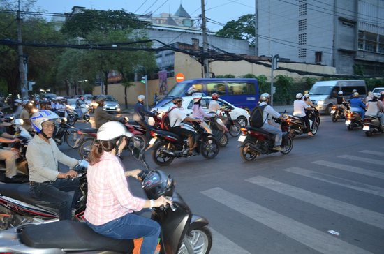 Saigon Prince Hotel: local traffic near hotel
