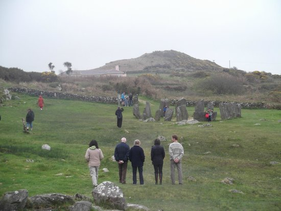 Drombeg Stone Circle: My friends looking at stone circle