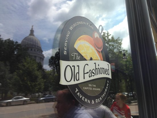 The Old Fashioned window sign with Capitol Building reflection