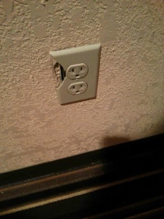 The Annex at The Chelsea: Broken outlet in the hallway
