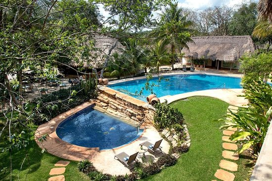 The Lodge at Uxmal: Pool and gardens area