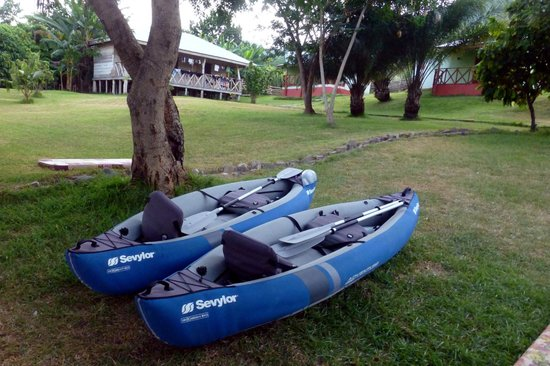 Cocoa Village Guesthouse: Boats for rent & Dorm rooms beyond